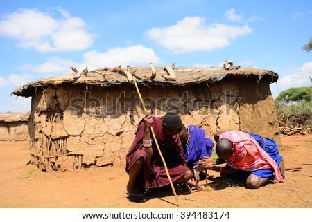KENYA - FEBRUARY 23 : Maasai man ligthing fire on 23 February 2016 in Kenya. The Maasai are an indigenous tribe of Kenya and Tanzania. - stock photo
