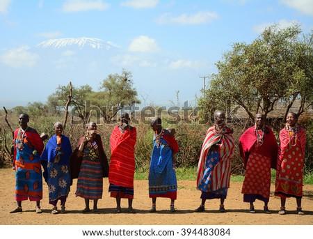 KENYA - FEBRUARY 23 : Maasai men and the Kilimanjaro at 23 February 2016 in Kenya. The Maasai are an indigenous tribe of Kenya and Tanzania. - stock photo