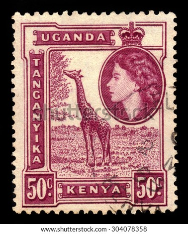 KENYA, TANGANYIKA, UGANDA - CIRCA 1954: stamp printed by Great Britain, shows giraffe and Queen Elizabeth II, circa 1954 - stock photo