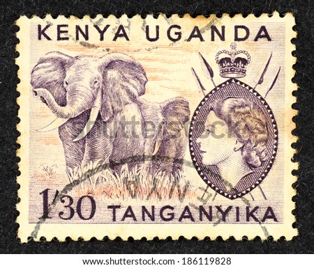 KENYA UGANDA - CIRCA 1957: Purple color postage stamp printed in Kenya Uganda with image of a pair of wild African elephant.  - stock photo