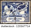 KENYA UGANDA TANGANYIKA - CIRCA 1949: A stamp printed in Kenya Uganda Tanganyika issued for the 75th anniversary of UPU shows UPU Hemispheres, Vickers Viking airliner and steamer, circa 1949. - stock photo