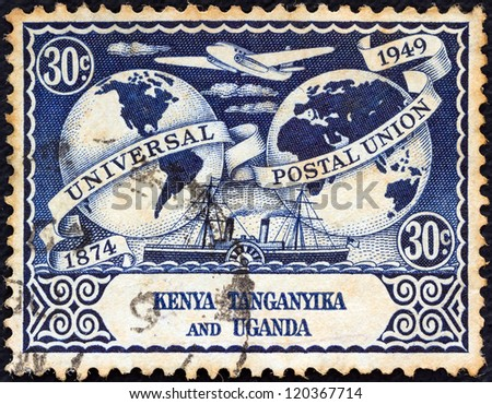 KENYA UGANDA TANGANYIKA - CIRCA 1949: A stamp printed in Kenya Uganda Tanganyika issued for the 75th anniversary of UPU shows UPU Hemispheres, Vickers Viking airliner and steamer, circa 1949. - stock photo