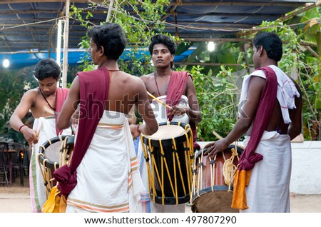 KERALA, INDIA - JANUARY 15, 2016: Indian drummers playing Chenda drums during Theyyam ceremony