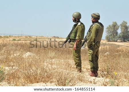 KEREM SHALOM, ISR - JULY 05:Israeli soldiers near Gaza strip on July 05 2010.IDF is one of Israeli society's most prominent institutions, influencing the country's economy, culture and political scene - stock photo