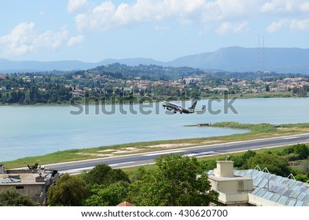 KERKYRA, GREEES - MAY 14: The aircraft of Ryanair Airlines taking off in Corfu International Airport on May 14, 2016 in Kerkyra, Greece. Up to 16 mln tourists is expected to visit Greece in year 2016. - stock photo