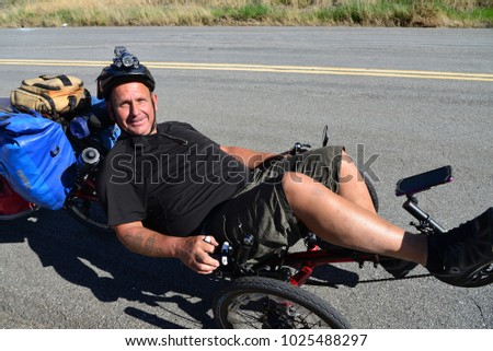 KERN COUNTY, CA - FEBRUARY 11, 2018: William Galloway, known as Bicycle Bill, a victim of a car bike crash is criss-crossing the USA on his trike as an advocate for head trauma research and treatment.