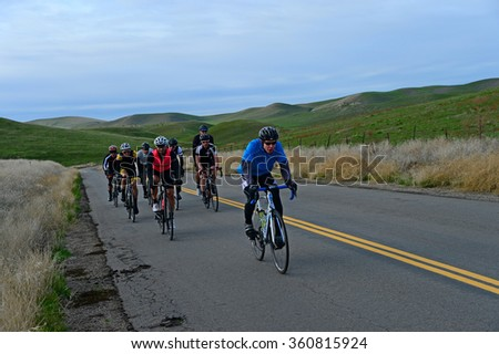 KERN COUNTY, CA - JANUARY 9, 2016: Cyclists from the city climb into the Sierra Nevada Range under winter skies on a training ride in order to regain the fitness lost over the holidays.