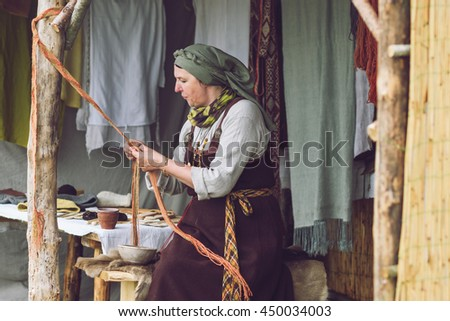 KERNAVE, LITHUANIA - JULY 10, 2016: 17th International Festival of Experimental Archaeology. Crafts in the Middle Ages