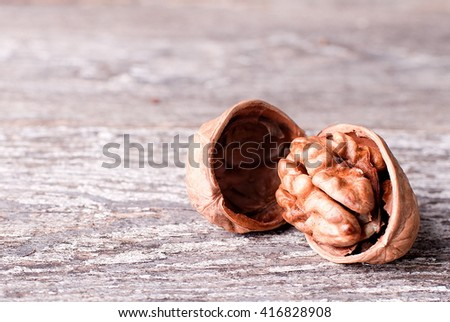 kernel of walnut on the old board - stock photo