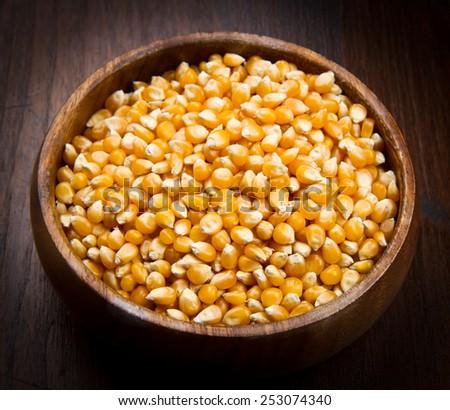 kernels, Corn seeds on wood bowl - stock photo