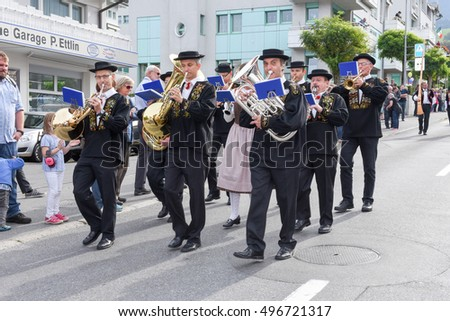 Kerns, Switzerland - 1 October 2016: People wearing traditional clothes and playing music on the streets of Kerns on the Swiss alps