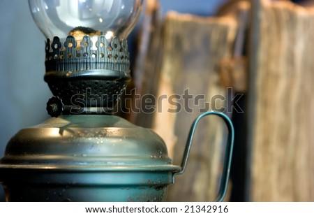 Kerosene lamp and some old books - stock photo