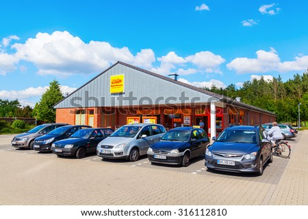 KERPEN, GERMANY - SEPTEMBER 10, 2015: Netto supermarket with unidentified people. Netto Marken-Discount is a German supermarket chain, owned by the largest German supermarket cooperative Edeka Group