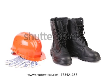 Kersey boots and hard hat on gloves. Isolated on a white background.