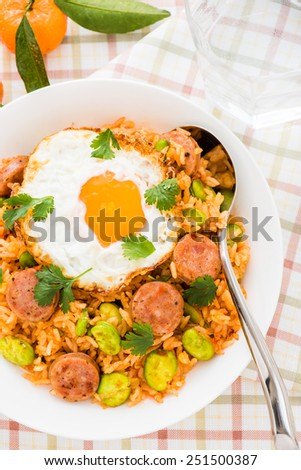 Ketchup Fried Rice with Sausage, Board Beans Topped with Sunny Side Up Egg