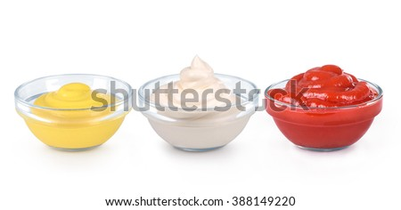ketchup, mustard and mayonnaise in glass bowls - stock photo
