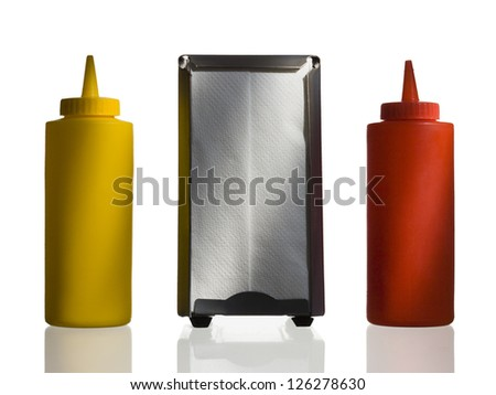 Ketchup, mustard and napkin dispenser on white background - stock photo