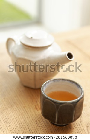 kettle and tea cup on table - stock photo
