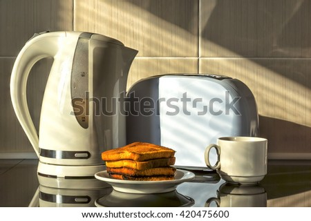 Kettle and toaster. - stock photo