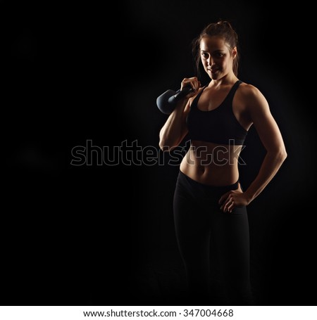 Kettle bell fitness woman - stock photo