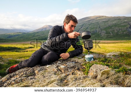 kettle boiling on a gas stove in the mountain camping