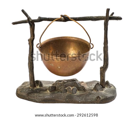 kettle hanging over the fire metal figurine isolated on white background - stock photo