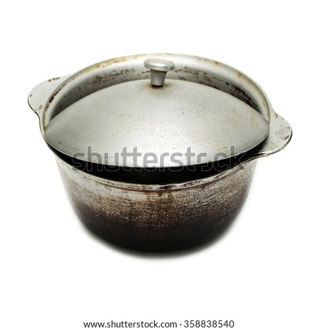 kettle, old black pot with lid isolated on white background - stock photo