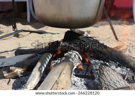 Kettle on fire  - stock photo