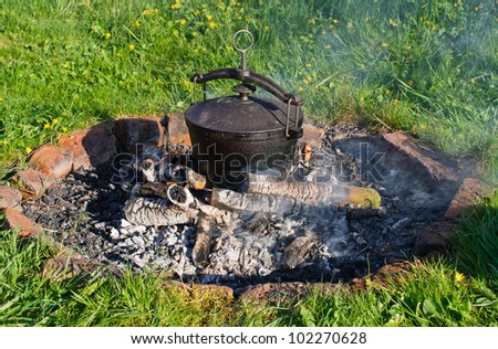 Kettle on fire in the garden - stock photo