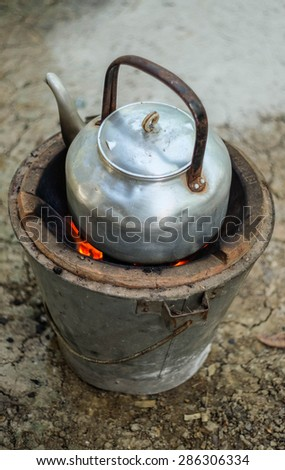 Kettle On Fire Stove of my Grandfather  - stock photo