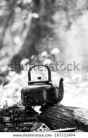 Kettle on the camping - stock photo