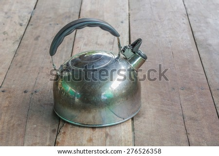 kettle on the wooden background - stock photo
