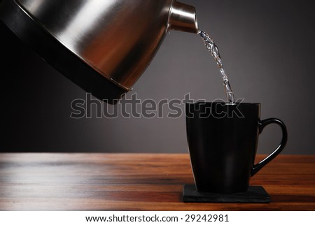 Kettle pouring into mug