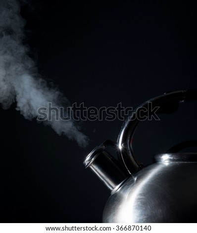 kettle whistling, boiling kettle, steam, isolated on a black background - stock photo