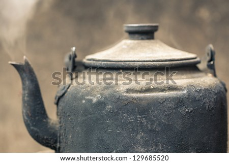 kettle with boiling water - stock photo