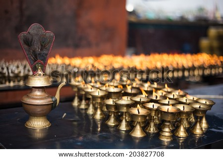 Kettle with lighted candles in front of one of the temples in Kathmandu