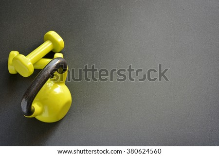 kettlebell with medicine ball and two dumbbells and a rope to jump - stock photo