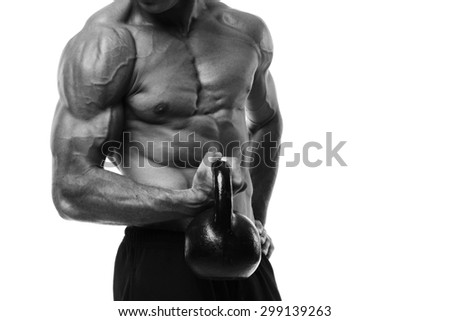 Kettlebell Workout. Closeup of muscular torso and arm with hand holding a kettlebell. Black and white studio shot isolated on white.