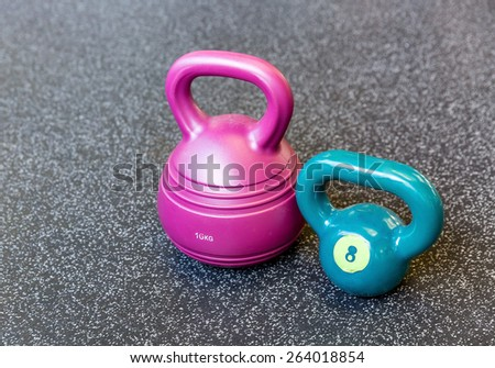 Kettlebells  in row at gym on the background of the floor - stock photo