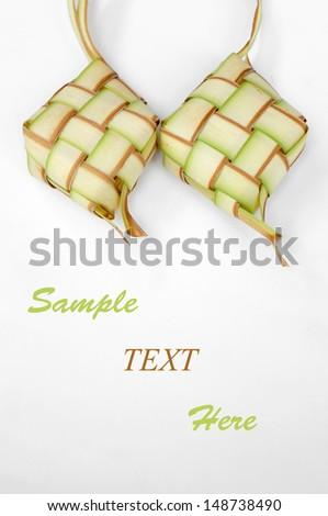 Ketupat on white background - stock photo