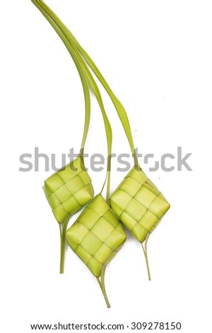 Ketupat on white background. Ketupat is the traditional food of Malaysia during the Hari Raya festival. It is made of palm leaves and a bit of rice included in it.(selective focus and soft focus) - stock photo