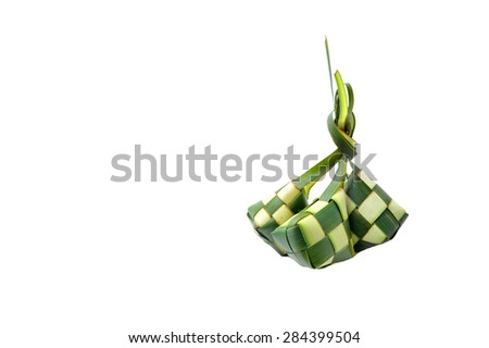 Ketupat or rice dumpling is a local delicacy during the festive season.Ketupat, a natural rice casing made from young coconut leaves for cooking rice on a white background - stock photo