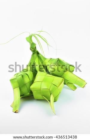 Ketupat (Rice Dumpling). Ketupat is a natural rice casing made from coconut leaf.  - stock photo