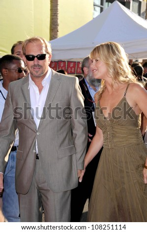 "Kevin Costner and Christine Baumgartner   at the Los Angeles Premiere of ""Swing Vote"". El Capitan Theatre, Hollywood, CA. 07-24-08"
