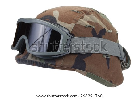 kevlar helmet with a camouflage cover and protective goggles isolated on white background