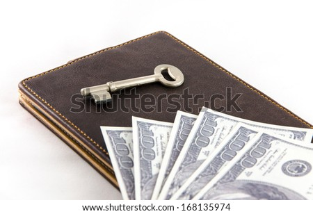 key and dollar bill on leather wallet - stock photo