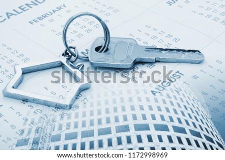 stock-photo-key-and-keyholder-on-calenda