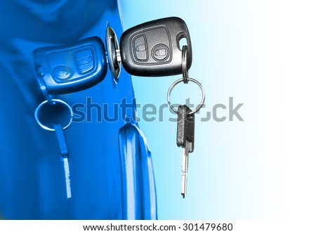 Key at car doors. Closeup with shallow DOF. Picture with space for your text. - stock photo