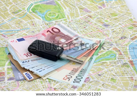 Key automotive, paper money euro and map