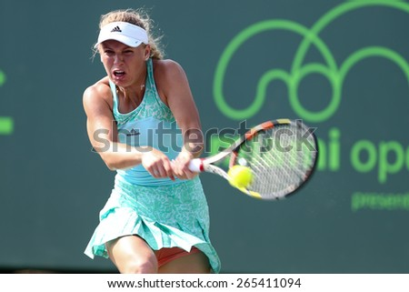KEY BISCAYNE, FL-MAR 26: Caroline Wozniacki of Denmark returns a shot during day four of the Miami Open at Crandon Park Tennis Center on March 26, 2015 in Key Biscayne, Florida. - stock photo
